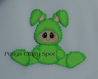 Kid in Green Easter Bunny Costume Sitting