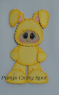Kid in Yellow Easter Bunny Costume Standing